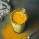 Golden milk with turmeric powder, clean eating detox concept